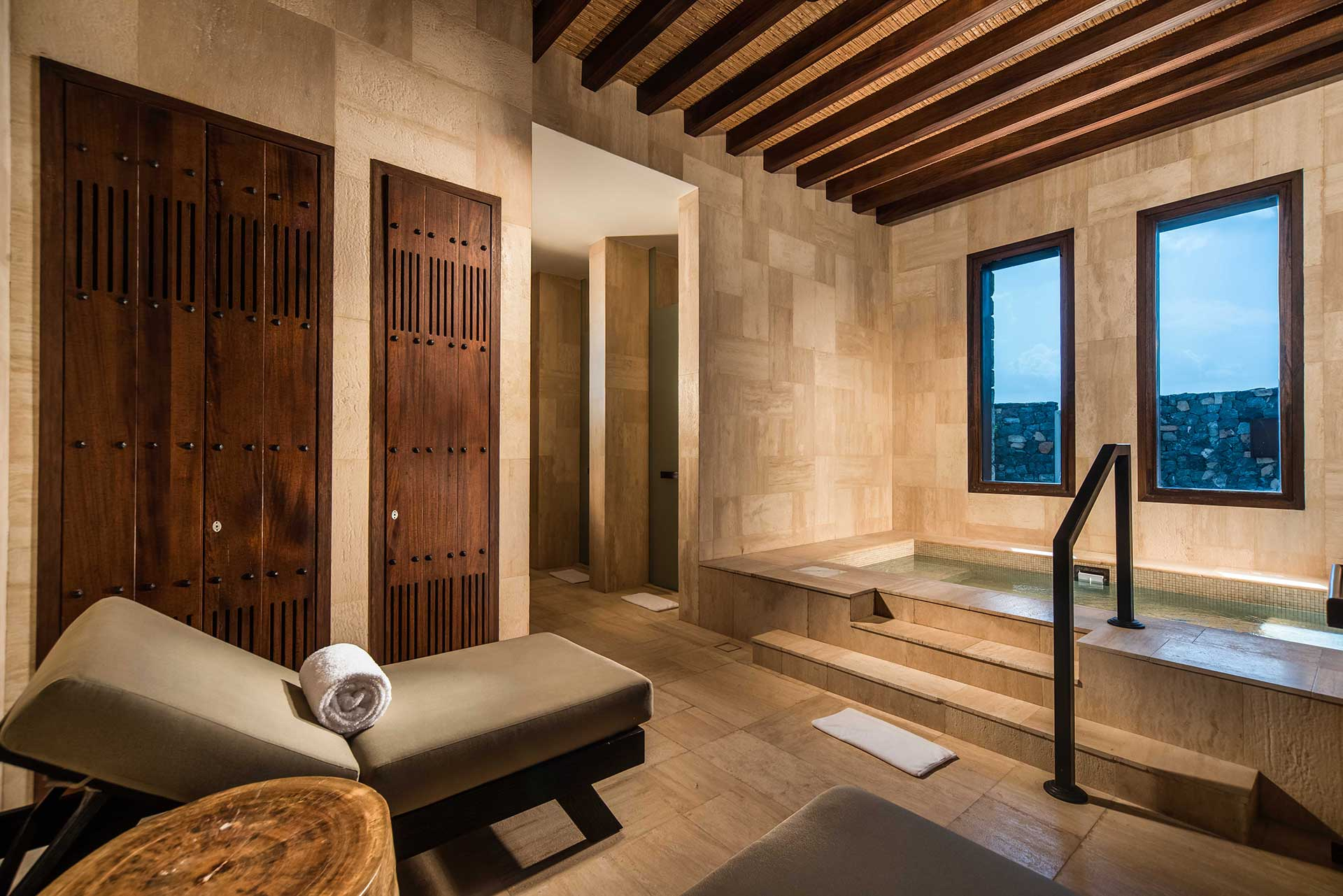 stone wall spa, chair and jacuzzi