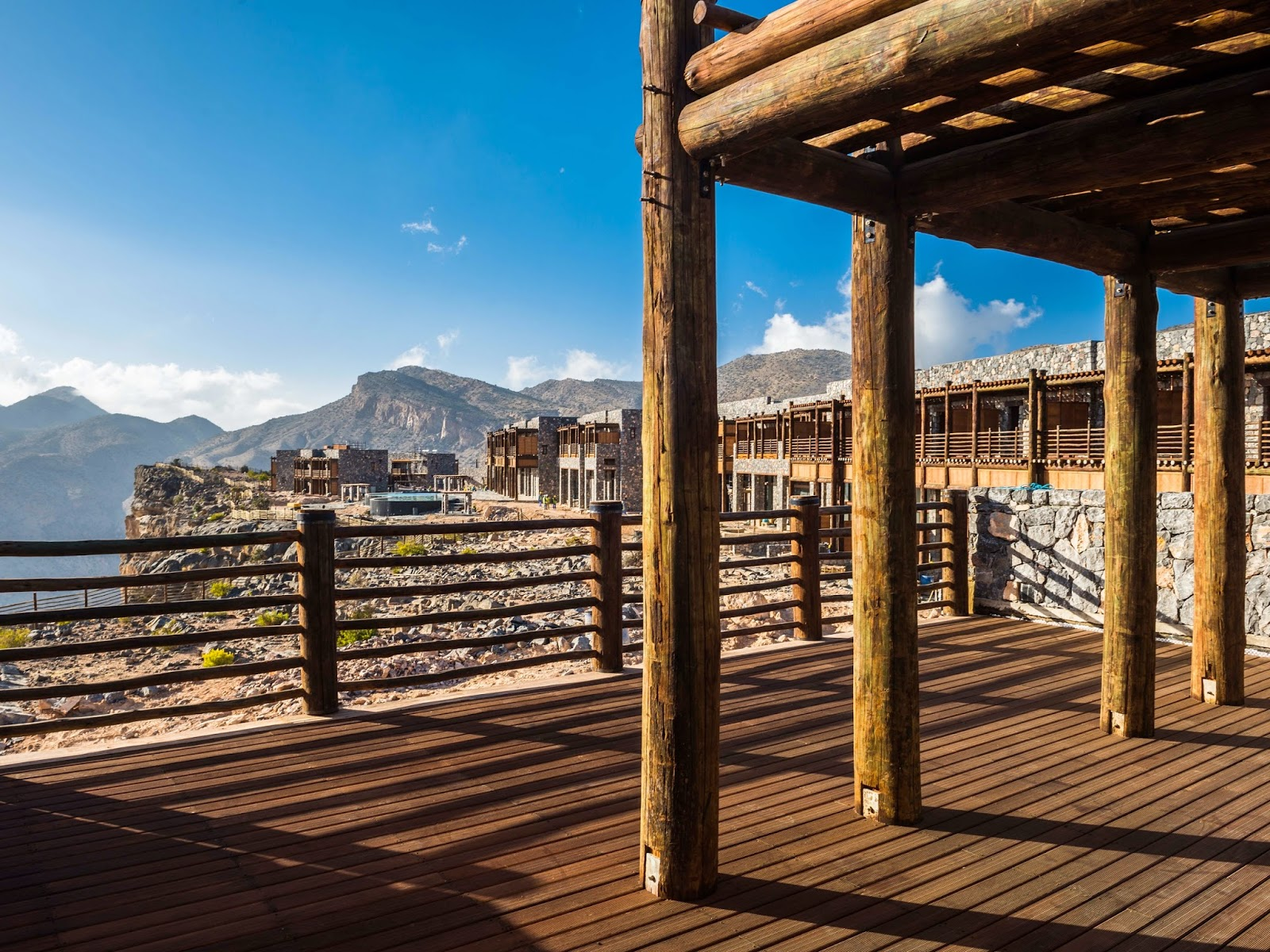 wooden terrace, blue skies and mountain views