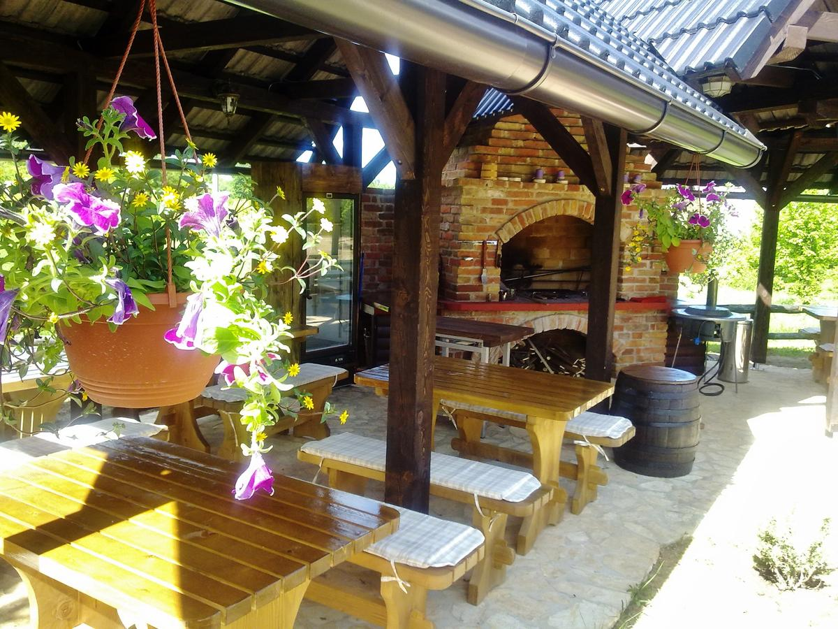 outside seating area, hanging flower baskets