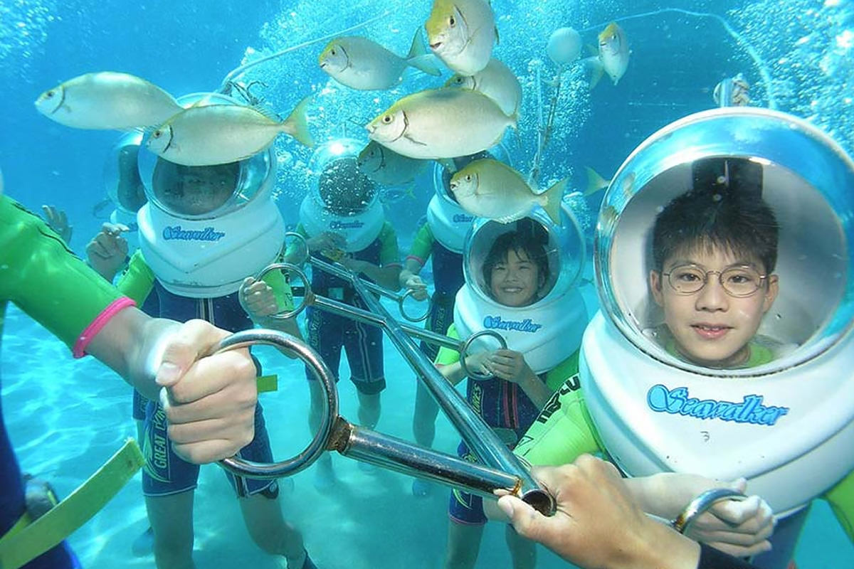 parents and children with underwater helmets