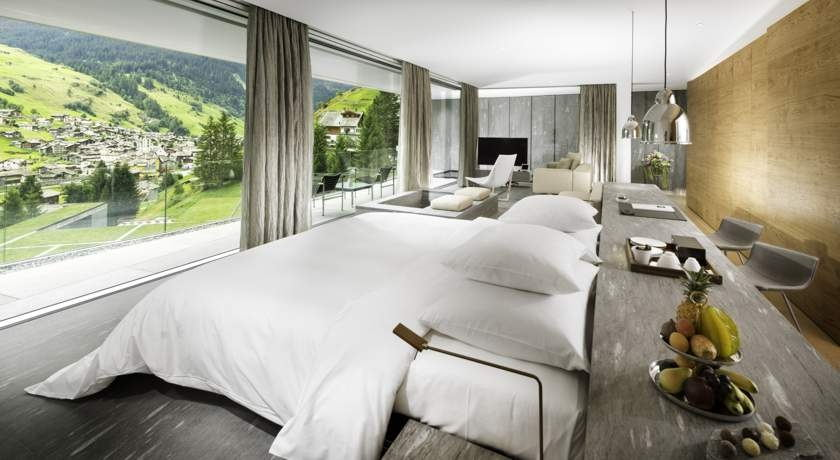 hotel suite, neutral colour, green mountain view