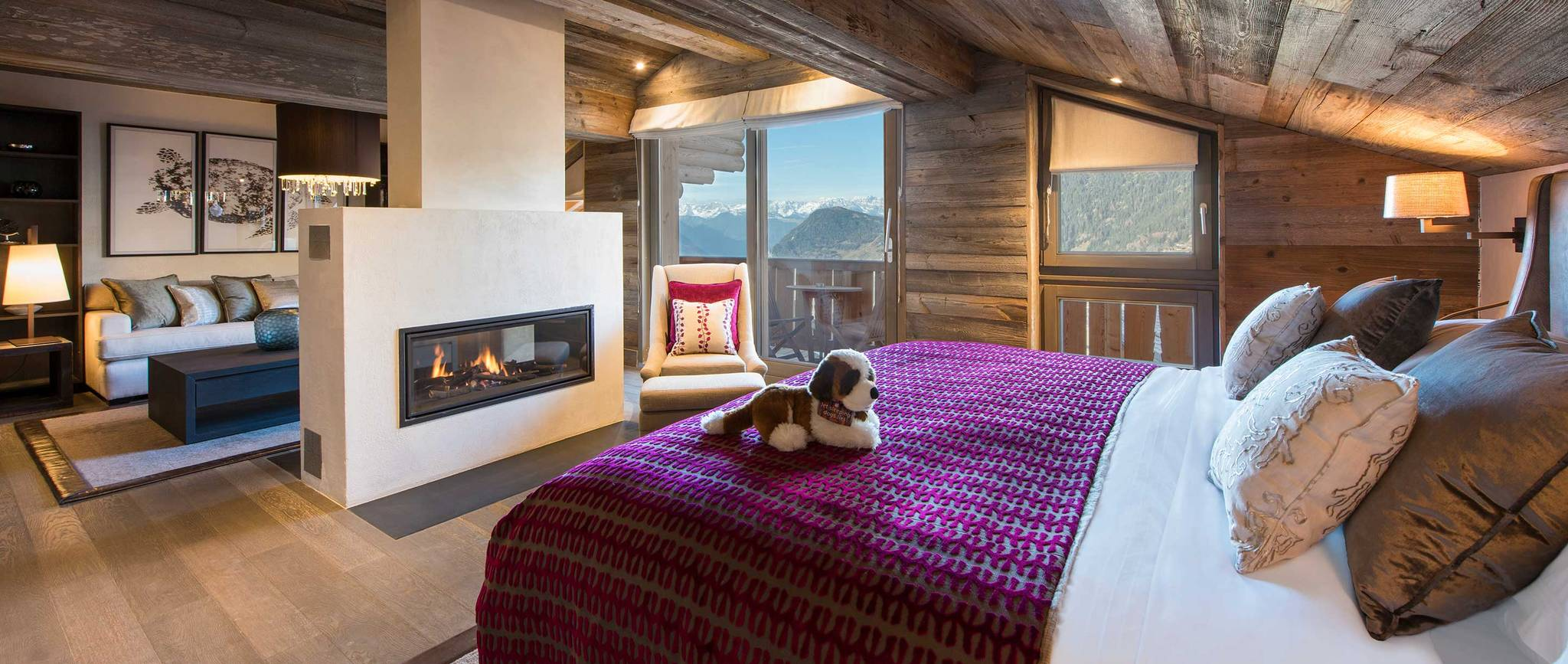 bedroom with toy puppy on bed and fireplace