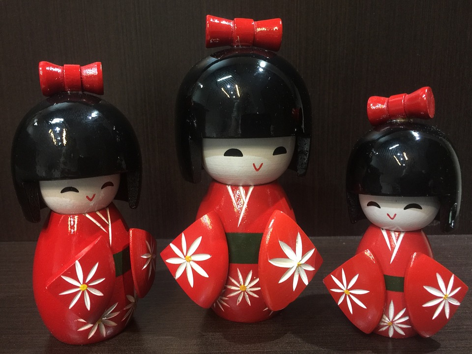 Three Japanese wooden dolls