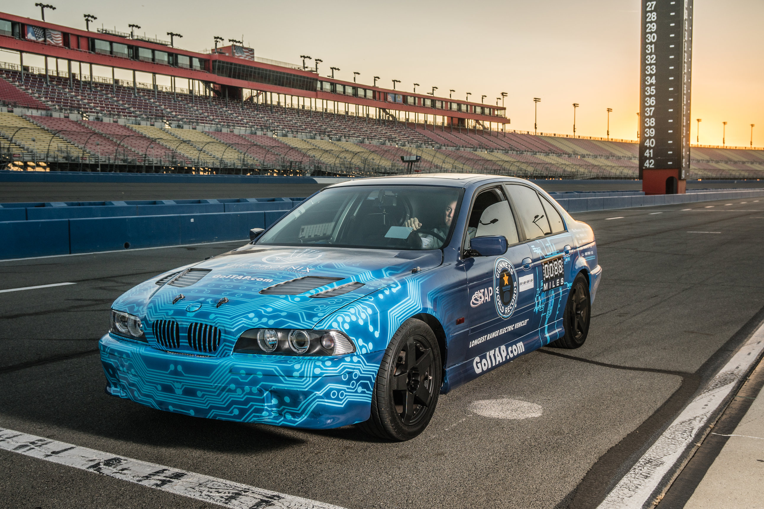 blue racing car on track
