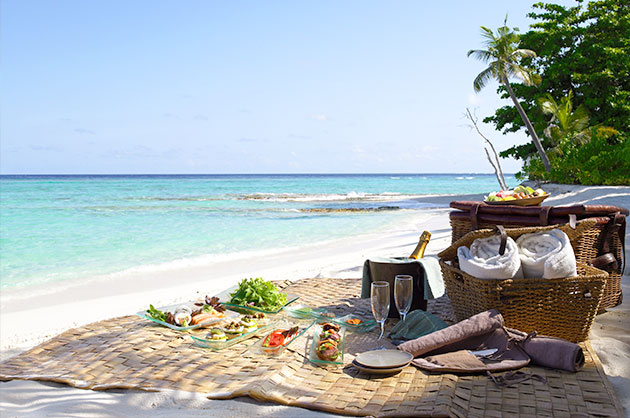 picnic set up on white sand beach