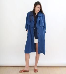 woman wearing blue linen trench coat