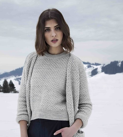 woman in grey sweater set with snowy background