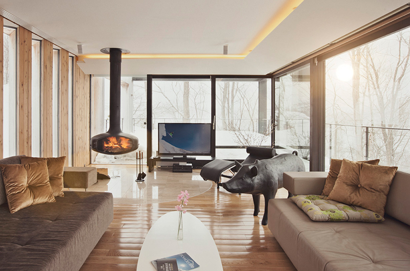 cozy ski chalet interior with hanging fireplace