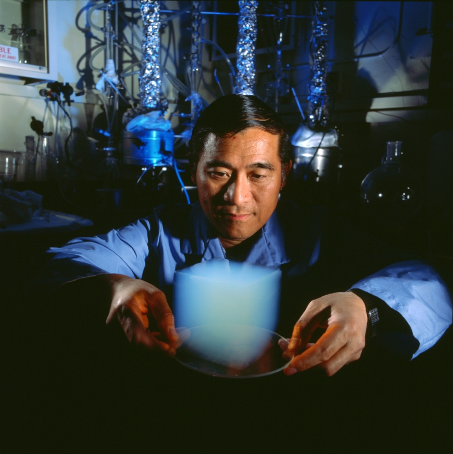 Asian man holding cube of aerogel on plate
