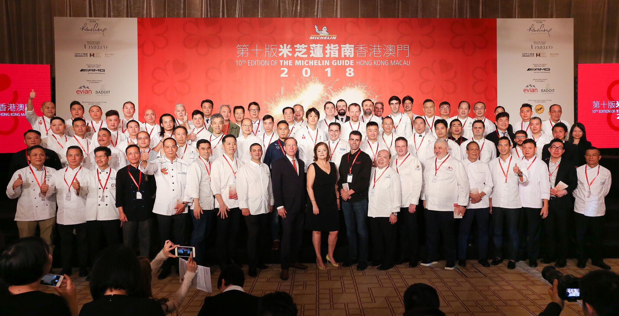 large group of chefs in white uniforms