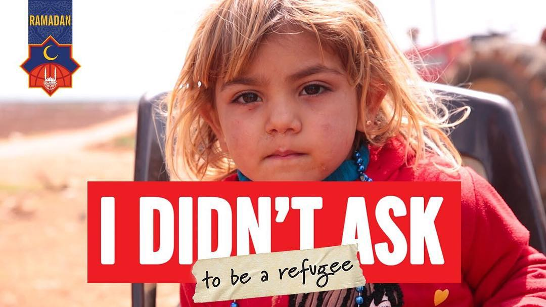 "boy with dirty face with the words ""I didn't ask to be a refugee"" on photo"
