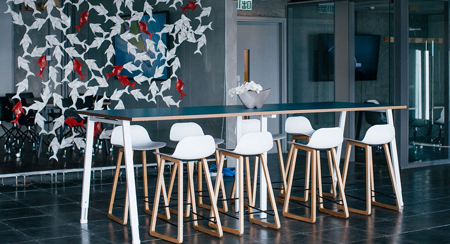 communal work table with white stools
