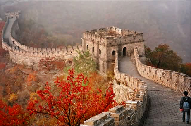 Great Wall of China with red autumn leaves