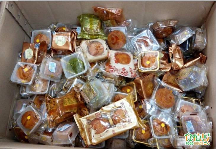 piles of individual cellophane-wrapped mooncakes in a box
