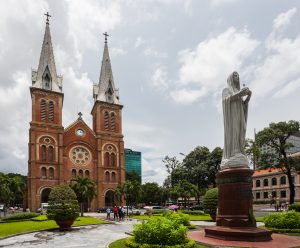 cathedral with two spires, statue