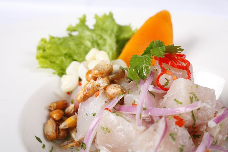ceviche with red onion and green lettuce