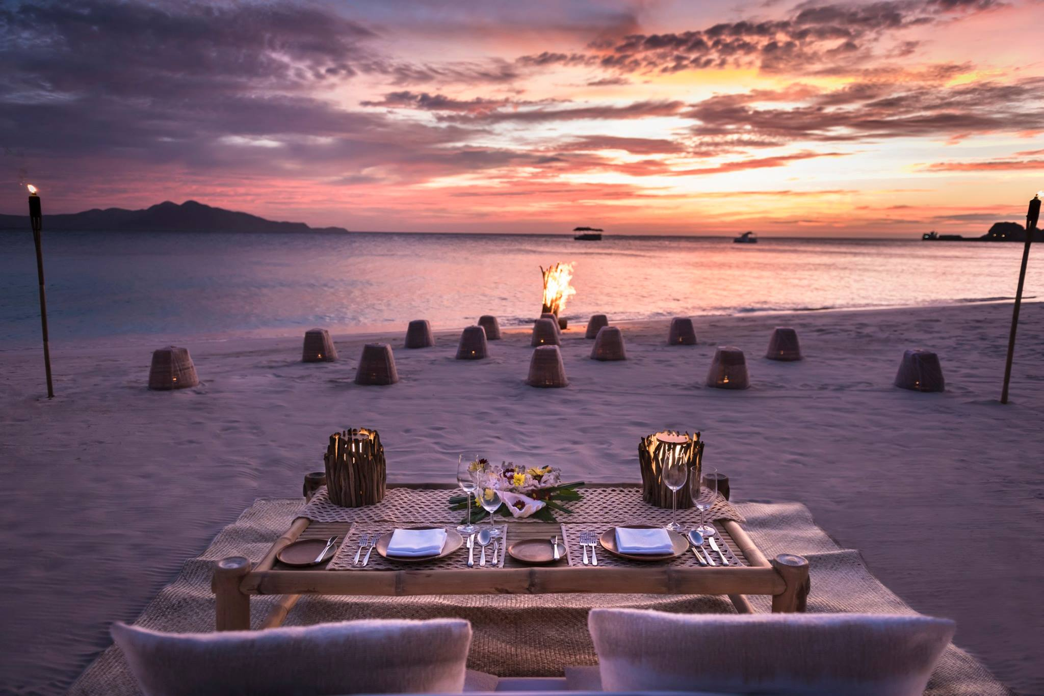 pink sunset dining on the beach