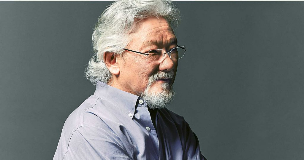 side profile of Dr. David Suzuki wearing glasses and a grey shirt