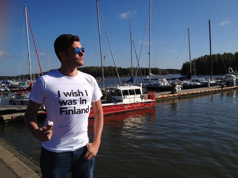 "man with sunglasses wearing t-shirt that says"" I wish I was in Finland"""