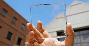 person holding small transparent solar cell up