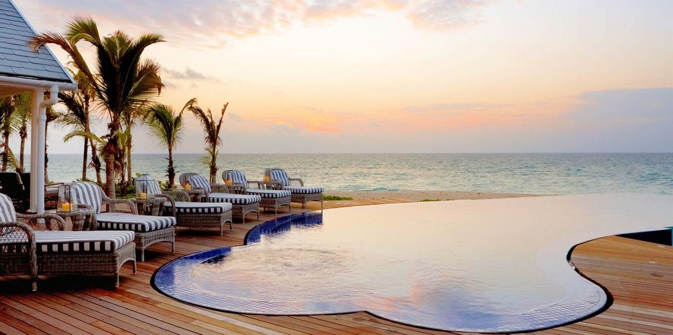 infinity pool overlooking ocean at sunset
