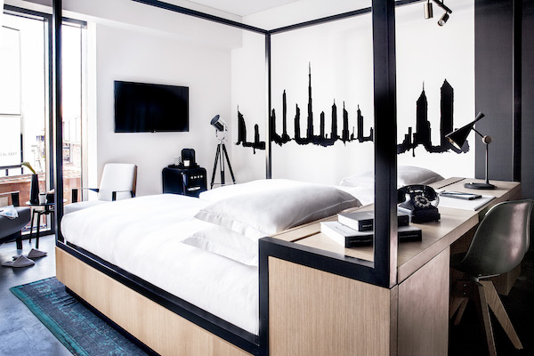 black and white bedroom with city outline wall mural