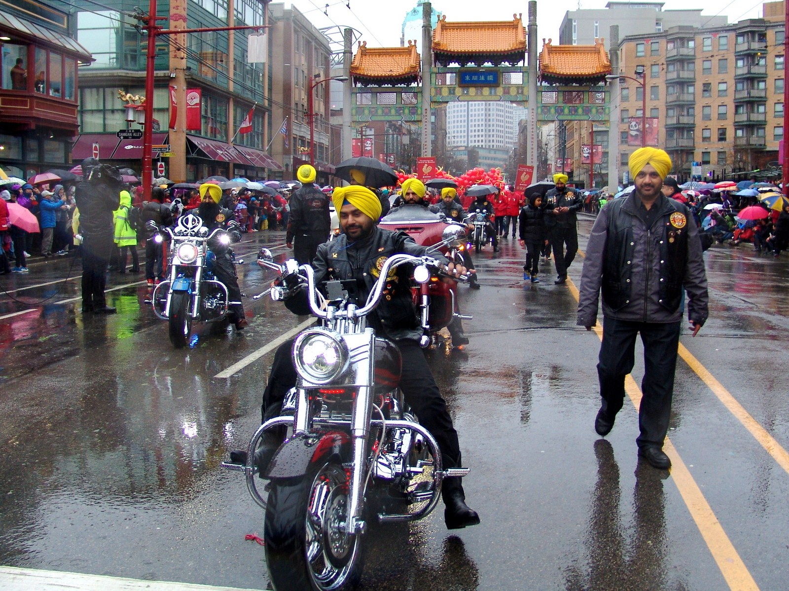 Indian Sikhs wearing yellow turbans on motocycles