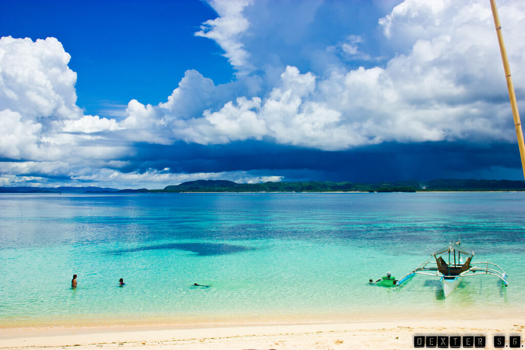 white sand, clear emerald water, blue sky