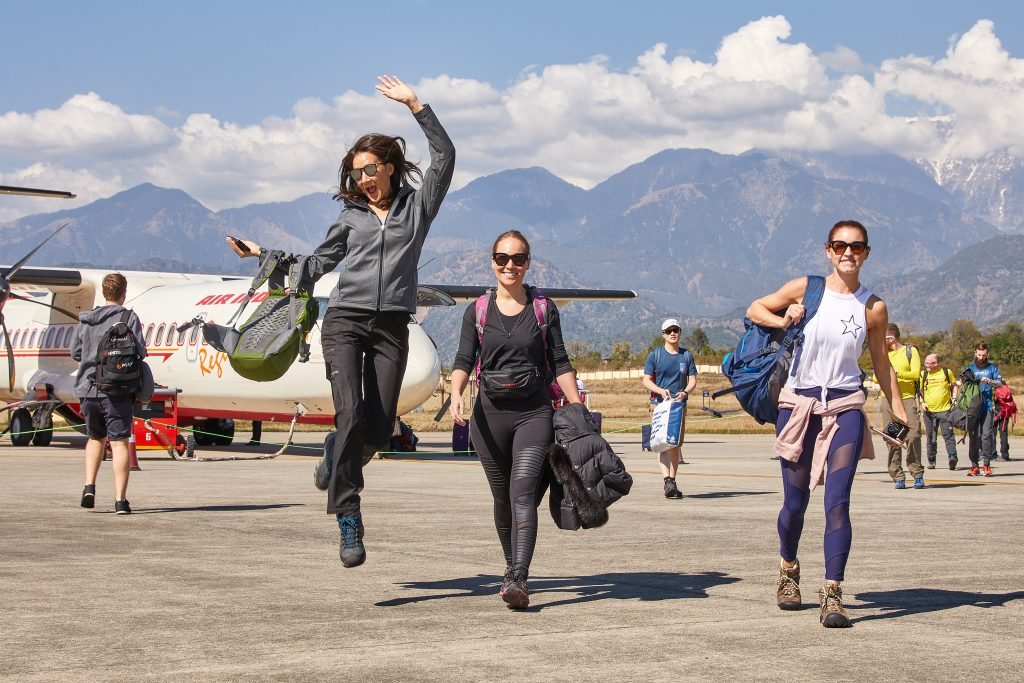 woman walking and jumping, airplane and back ground mountains
