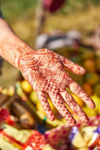 henna'd hand, outstretched palm up