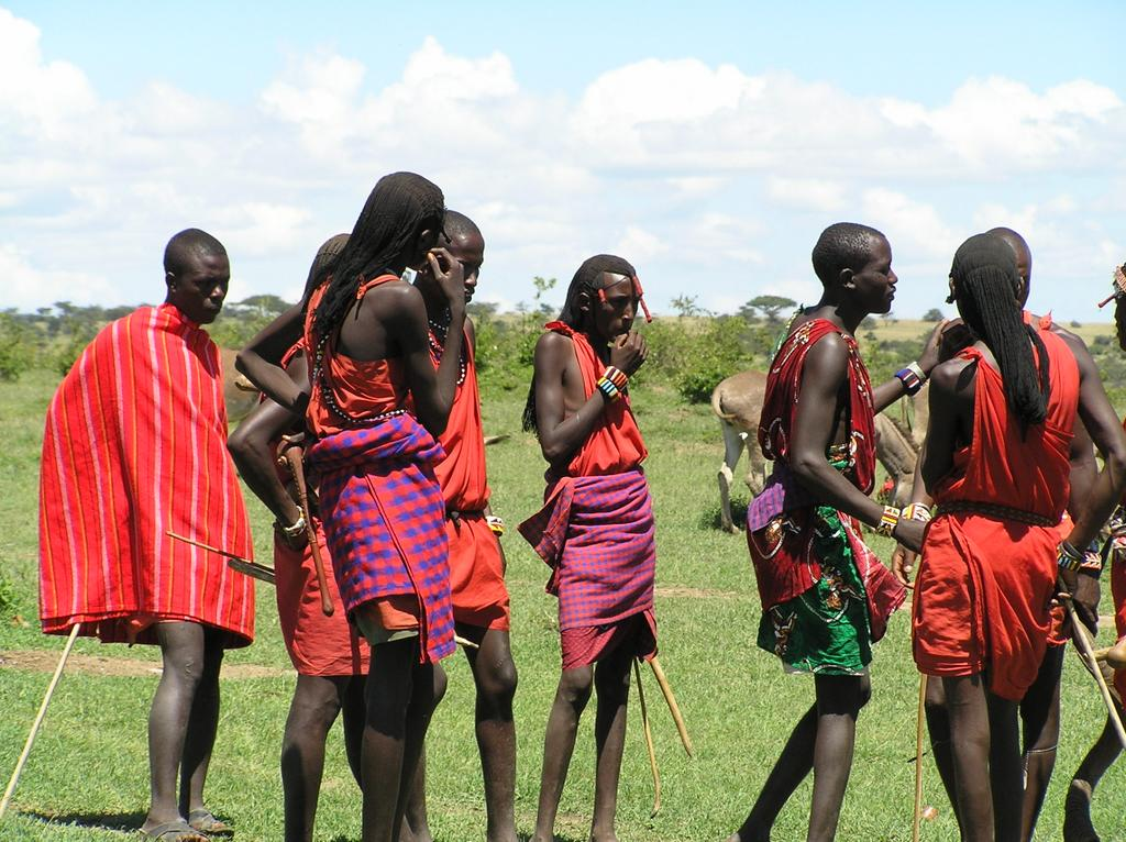 African Maasai warriors in red and pink wraps