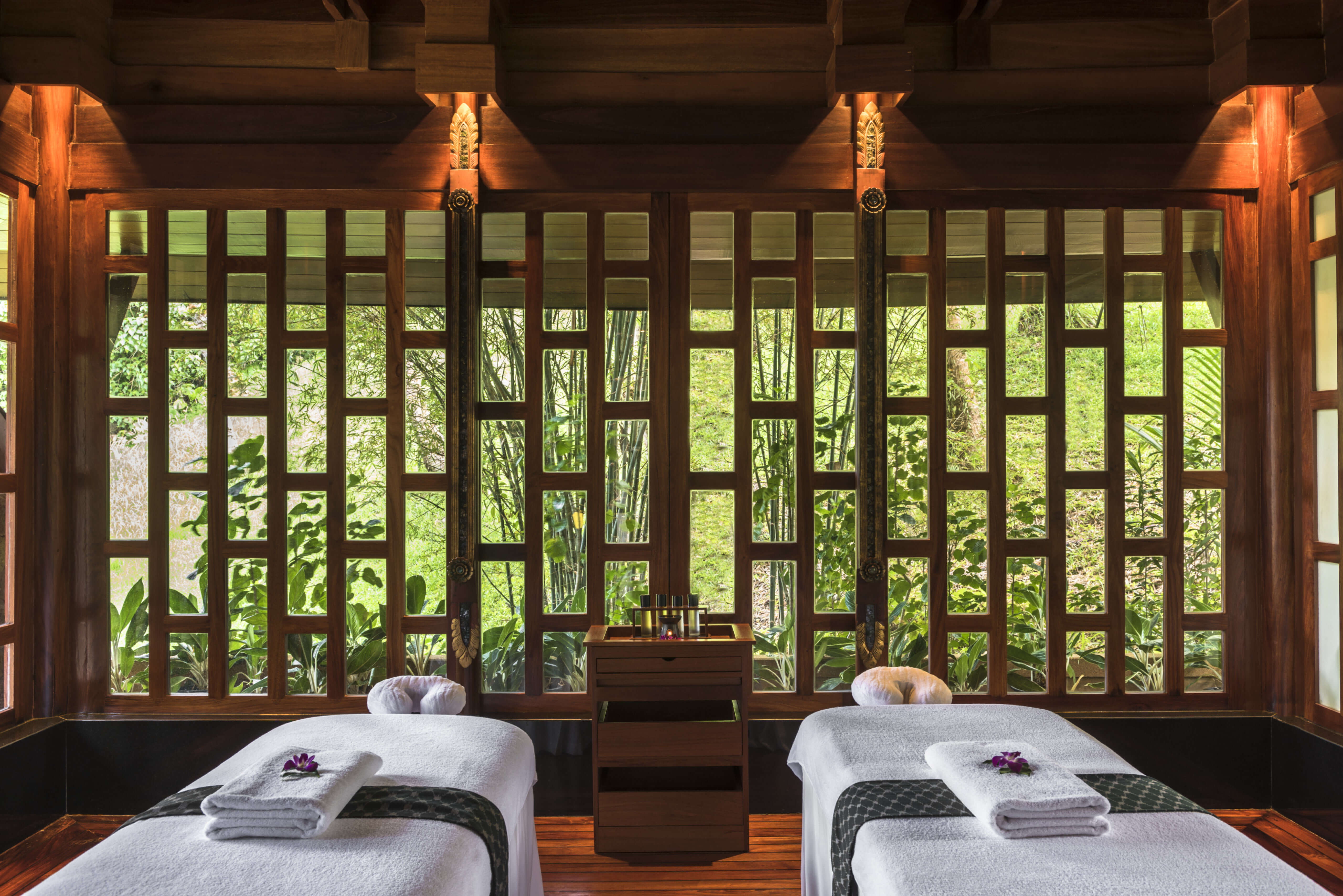 two spa beds in wooden decorated spa room