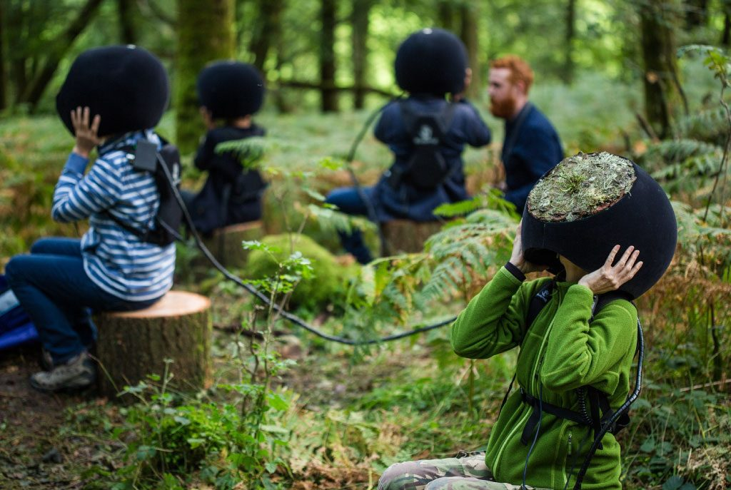 Wonderfruit participants experiencing virtual reality in nature